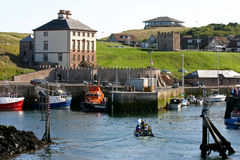 Eyemouth Harbour, Scotland. View over Eyemouth harbour to Dunsgreen House Royalty Free Stock Photo