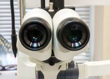 Eyepieces of ophthalmologic device slit lamp closeup in Office of ophthalmologist. Photos of diagnostic procedure of eye disease. S such as glaucoma, cataracts royalty free stock photo