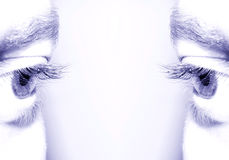 Eyes. Beautiful eyes frame with copyspace in blue monochrome Stock Photography