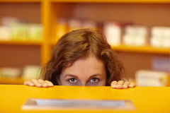 Eyes above the counter Royalty Free Stock Images