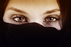 Eyes of arab woman with veil. Over face royalty free stock photography