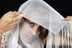 Eyes behind the curtains Royalty Free Stock Image
