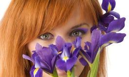 Eyes behind flower Stock Image