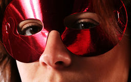 Eyes behind mask Royalty Free Stock Photography