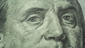 Eyes of Benjamin Franklin 100 dollars note close-up Royalty Free Stock Photo