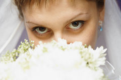 Eyes of bride and bridal bouquet Royalty Free Stock Images