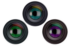 Eyes in camera lenses Royalty Free Stock Images