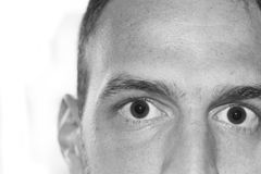 Eyes close up face. Pair of eyes of male focus on the eye isolated on white background wondering Stock Photo