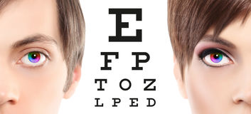 Eyes close up on visual test chart, eyesight and eye examination. Concept in white background royalty free stock photos