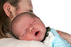 Eyes closed. Sleeping baby in his mother's arms, only 15 days old stock photography