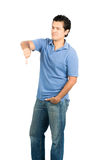 Eyes Closed Frowning Hispanic Male Thumb Down. Hispanic male in casual clothes with eyes closed, hand in pockeet and frowning facial expression, gesturing thumb Stock Images