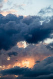 Eyes from the clouds. Magical sky with smoky stratocumulus clouds at sunset Royalty Free Stock Photo