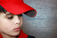 Eyes Downcast. Upset little boy looking down in thought Stock Images