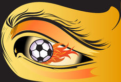 Eyes fire football sport. Graphic beauty of the eyes. Fiery soccer power thirst of victory. Walkin 'with the football Stock Photo