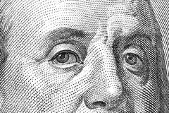 Eyes of Franklin. Macro shot of the eyes of Ben Franklin from a $100 bill Stock Images