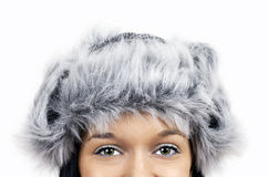 Eyes and furry grey hat Royalty Free Stock Photography