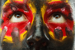 Eyes of Germany sports fan patriot. Painted country flag on man face. Stock Image