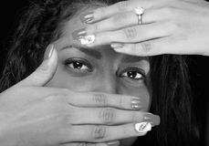 Eyes of girl behind hands Royalty Free Stock Photos