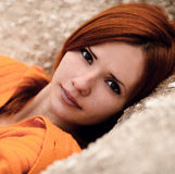 The portrait of very beautiful red-haired, cute, nice, attractive girl. Royalty Free Stock Photos