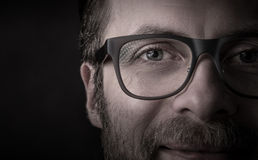 Eyes and glasses - man`s face close up macro Stock Photo
