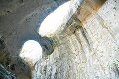 Eyes of God, Prohodna Cave, Bulgaria. The Eyes of God formation in the Prohodna cave Royalty Free Stock Photography