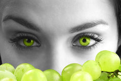 Eyes and grape Royalty Free Stock Image