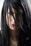 Eyes between hair Stock Image