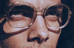 Eyes of handsome man in old fashioned glasses Royalty Free Stock Photo