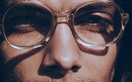 Eyes of handsome man in old glasses Royalty Free Stock Images