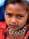Eyes of Hope. A poor Indian girl with a beautiful antique necklace looks with hope for money Royalty Free Stock Image