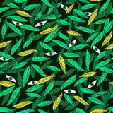 Eyes among the leaves seamless jungle pattern. Stock Images