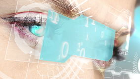 Eyes looking at holographic interface with binary code