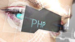 Eyes looking at holographic interface with coding words stock footage