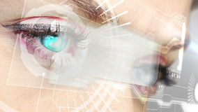 Eyes looking at holographic interface with coding words stock video footage