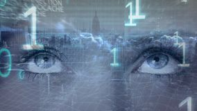 Eyes looking left to right and numbers foreground. Digital composite of eyes of female looking from left to right while numbers moving on the foreground and city stock footage