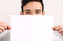 Eyes looking over a piece of paper. Stock Images