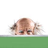 Eyes of a madman bald oldman by the school board Royalty Free Stock Image