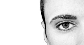 Eyes of a man. Close up of the eye of a young man Stock Photography