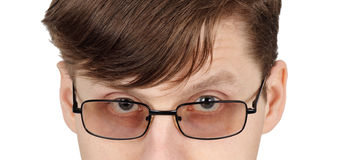 Eyes of man with glasses Stock Photos
