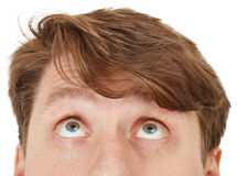 Eyes of man look upwards, close up Stock Image