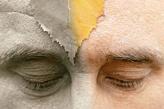 The eyes of the man are looking down at the sheet of the forehead. half of the image is colored silvery. The arrival of old age ca stock photos