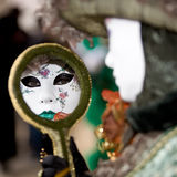 Eyes in a mirror. A woman with a venetian mask looking into a mirror Royalty Free Stock Photos