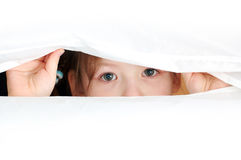 Eyes is a mirror of soul. A young girl look at you. Close-up. Over white background Royalty Free Stock Photo