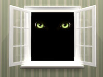 Eyes of monster  in open window Royalty Free Stock Images