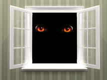 Eyes of monster  in open window Royalty Free Stock Photography