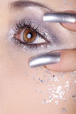 Eyes and nails in silver Royalty Free Stock Photo