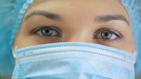 Eyes of a Nurse at surgical mask stock video footage