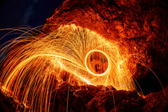 Eyes are painted burning steel wool in the mountain Royalty Free Stock Photo