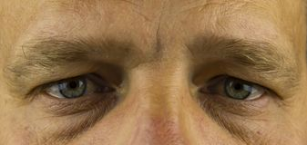 Eyes of a person without a face - middle-aged men royalty free stock photo
