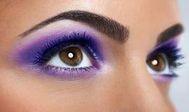 Eyes with purple makeup. Closeup of beautiful eyes with purple makeup Stock Image